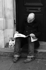 DSC01993 - Outside Whitechapel Art Gallery (roger_thelwell) Tags: life street city uk winter portrait england people urban bw white black streets cold reflection brick london monochrome face hat mobile hair walking real photography mono newspaper chat phone faces natural photos britain candid great hats cell railway photographic east photographs lane end conversation talking spitalfields speak speaking commuters aldgate