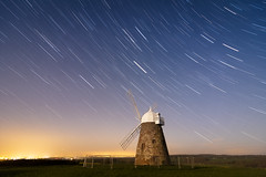 sky building windmill field grass composite night fence dark stars lights evening haze westsussex dusk country clear trail nightsky startrails chichester lightpollution startrail southdownssails