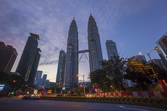 Kuala Lumpur, Malaysia - March 04, 2017: Road junction at Suria Klcc with Petronas Twin Towers and Office Buildings at Blue Hour and rush hour morning. (MEzairi) Tags: architecture asia blue building bus busy car city cityscape editorial highway hour junction kl klcc kuala landmark landscape light lumpur malaysia mall metropolis morning motor night office pedestrian petronas rush shopping sky skyline skyscrapers suria trail twilight twin use working