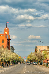 Traverse City ... downtown blossom time (Ken Scott) Tags: usa clouds spring michigan blossoms may clocktower traversecity hdr frontstreet verticalpanorama usaflag 45thparallel grandtraversecounty 2013