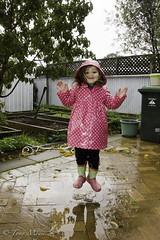 rainy day angel (moyzie out and about) Tags: fun jumping south daughter australia days rainy adelaide raincoat puddles pinoy levitate filoz