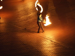Playing with Fire - Fire Poi in San Francisco, On the Embarcadero (In front of the Vaillancourt Fountain) (tipsen) Tags: sanfrancisco street light art night pen fire performance olympus flame poi 150mm epl1