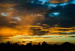 Just another sunrise... (Angelo G.I.O.) Tags: city morning blue sky orange sun sunlight home nature night clouds composition sunrise thailand 50mm morninglight nikon asia availablelight bangkok silhouettes nikkor sunrays naturalight colrs sunglare thebalcony naturalscenery nikond3000 taypeemansion