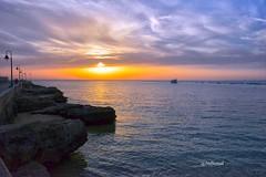 Sunset on the Caletas beach, Cadiz, Andalusia, Spain (Jmbernalbreizh) Tags: sunset sea sky sun clouds spain rocks cadiz andalusia hdr thecaletasbeach
