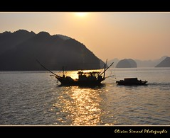 Near Cat Ba Island (Olivier Simard Photographie) Tags: ocean voyage morning travel sea sky sun mer clouds sunrise landscape island soleil boat asia dragon pirates unescoworldheritagesite vietnam ciel asie hutong nuages bateau pcheur along risingsun halong chine halongbay matin catbaisland le pche chinasea jonque gulfoftonkin baiedhalong vnhhlong jonques merdechine patrimoinemondialdelunesco descendingdragon karstique golfedutonkin mygearandme mygearandmepremium mygearandmebronze hutongbay oliviersimardphotographie