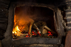 [2013-03-18@11.43.57a] (Untempered Photography) Tags: history fire cornwall oven smoke flame heat nationaltrust twigs 14thcentury tintagel gorse canonef50mmf14 clayoven tintageloldpostoffice untemperedeye canoneos5dmkiii untemperedeyephotography cloamoven ovenfiring cloamovenfiring2013