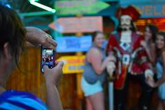 As mom lines up the shot (radargeek) Tags: florida cellphone pirate fl fortmyers shootingtheshooter saltysamsmarina parrotkeycaribbeangrill