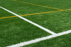 background of lines on football turf (Mimadeo) Tags: wallpaper white game green texture field grass playground sport yellow training chalk football play stadium background soccer lawn stripe ground competition artificial line turf