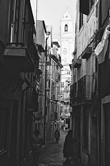 the past is just around the corner (marin.tomic) Tags: old city travel urban blackandwhite bw history film portugal church monochrome analog alley europe minolta lisboa lisbon retro fujifilm lissabon analogue oldtown portuguese alfama fujifilmsuperia400