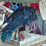 Crow paper sculpture left in honour of Iain Banks' The Crow Road