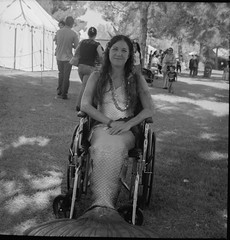 Mermaid (magnetic_red) Tags: yashicad tlr d76 tmax100 mermaid wheel chair smiling outdoors sitting trees