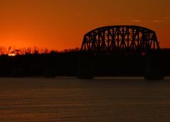 Into The Darkness (Phyllis74) Tags: sunset water silhouette night river ohioriver railbridge 14thstreetbridge