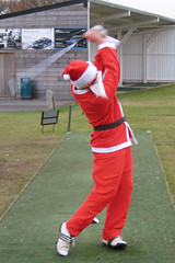 003 - Nice controlled follow through Santa! (Neville Wootton Photography) Tags: golf humour fatherchristmas canonixus70 stmelliongolfclub nevillewootton martynhunkin mensgolfsection 2010golfseason redhedzrollupxmastrophy