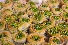 Tasty bakes (Etai Fishler) Tags: light food brown white macro green beautiful closeup vintage eos israel dof market wide 55mm tlv 18mm eos600d canont3i