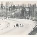 Children sledding on a snowy road