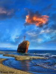 The trip has ended.... (amalia lam) Tags: blue sunset sea beach clouds canon landscapes waves ship dusk greece shipwreck seashore laconia deepblue peloponnese dimitrios gythio gytheio peloponnesus githio amalialampri