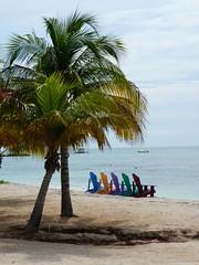 Beachside (matthewsdean78) Tags: ocean cruise shadow cloud sun tree beach water set clouds boats island boat sand chair waves salt sails wave aruba sail rise isands