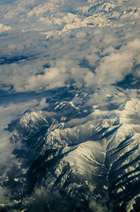 Mountain never grows old (LynxDaemon) Tags: canada rockies mountains snow aerial clouds view vintage postcard