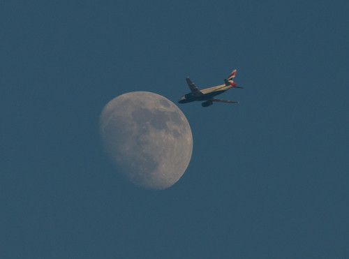 Jet approaching the early evening Waxing Gibbous Moon 21 May 2013