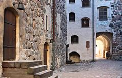 inside the medieval castle walls (rosipaw) Tags: windows castle morninglight doors turku medieval walls