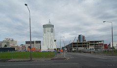 Things are Greening Up (Jocey K) Tags: road street newzealand christchurch sky people tree cars architecture clouds buildings cranes cbd greeningtherubble