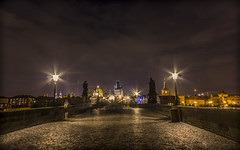 A night walk on Charles bridge (Vagelis Pikoulas) Tags: old city bridge autumn houses light sky people house reflection tower night canon landscape eos lights town kiss europe exposure republic view czech prague charles praha x4 karluv