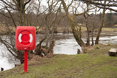Life saver (By: Fabio Gomes Freitas) Tags: life uk trees red white lake cold nature wet grass canon river scotland wooden belt sand chair scenery stream tour mud wind lakes dry windy save bark callander saver teith barks tithe