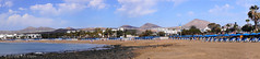 Panorama (villeveta) Tags: beach borås lanzarote matagorda puertodelcarmen sten sverige sweden veli vilppu hav lava ocean panorama strand tías canarias spanien es volcanoes vulkaner parasoll parasol flags flaggor