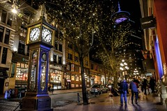 Night lights and life  in Historic Gastown (Christie : Colour & Light Collection) Tags: barrelwrappedscene gastown vancouver britishcolumbia bc historic landmark gastownsteamclock horologist 1977 turnofthecentury earlycentury worldrenowned westminsterchimes cobblestone warehouses nightphotography explorevancouver nikon night afterdark dark evening shopping earlytomid1900s historicwarehouses canadianhistory history clock streetphotography nightlife walk lamplight touristdestination mood winter