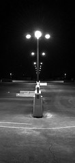 Aligned (glo photography) Tags: california gloriasalvanteglophotography northerncalifornia santarosaca sonomacounty architecture blackandwhite downtown garage lightpoles lights monochrome night outdoor urban winter