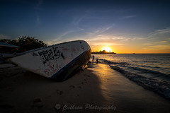 Shipwreck Sunset (John Cothron) Tags: antiguafebruary2017 antiguaandbarbuda caribbeansea cothronphotography dickensonbay johncothron saintjohn stjohns beach boat clearweather cloud cold color eveninglight island landscape nature ocean outdoor people saltwater scenic sky sun sunset travel tropical water winter img16037170216 ©johncothron shipwrecksunset