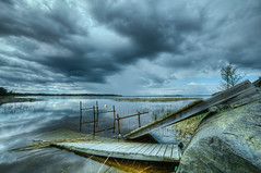 Sleeping through a storm (Appe Plan) Tags: old bridge trees wild summer sky seascape storm nature water rain clouds forest port landscape coast nikon rocks waves view sweden wideangle karlstad shore wilderness hdr hammar pire appe 14mm samyang