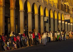 People Waiting For A Bus In Front Of The Arcades, Asmara, Eritrea (Eric Lafforgue) Tags: africa sunset color colour building men horizontal architecture outdoors photography togetherness italian day adult citylife sunny oldhouse decline groupofpeople adultsonly oldfashioned asmara eritrea hornofafrica eastafrica realpeople capitalcities eritreo buildingexterior colorpicture erytrea largegroupofpeople asmera eritreia colourimage italiancolony  ertra    eritre eritreja eritria colourpicture  rythre africaorientaleitaliana     eritre eritrja  eritreya  erythraa erytreja     colonialitalianarchitecture italiancolonialempire maekelregion ert6501