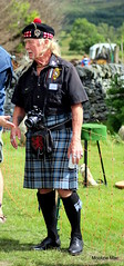 Canon camera (mootzie) Tags: camera black shirt canon scotland kilt games photograph marching tartan sporran newtonmore phtographer