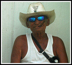 Cuban Faces (snaphappysal) Tags: santiago portrait man apartments faces guitar havana cuba trumpet cigar flats castro fidel trinidad housing caribbean che guevara doublebass