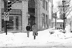 challenger (local paparazzi (isthmusportrait.com)) Tags: street windows winter blackandwhite bw white snow black cold building classic glass hat contrast scarf canon lost outdoors eos 50mm prime trafficlight pod missing midwest waiting downtown doors pavement iso400 buttons f14 coat go snowstorm streetphotography blowing right fresh sidewalk stop fancy flurries snowing usm madisonwi stoplight fullframe enter snowfall left blizzard confusion statestreet ef timeless wrongway autofocus 2014 leftturn isthmus rightturn whichway overturecenterforthearts 50mmf14usm danecountywisconsin daytonstreet fairchildstreet photoshopelements7 canon5dmarkii pse7 localpaparazzi redskyrocketman lopaps celebratewinter