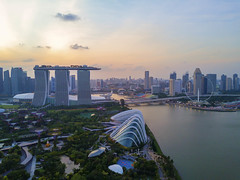 Singapore - February 11, 2017: Aerial view of sunrise scene of Marina Bay. Marina Bay is one of the most famous tourist attraction in Singapore. (MEzairi) Tags: aerial architecture asia bay building business city cityscape day district dji downtown drone editorial famous finance float fly landmark light luxury marina mavic metropolis modern night reflection river sands scene sea singapore sky skyline skyscraper stadium sunset tourism tower town travel urban view water waterfront