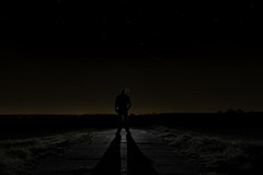 Nighttime Silhouette (Niaic) Tags: silhouette man outdoors shape contrast outline rimlight night dark stars sky starry grass path road field backlit mystery frightening tense fear fearful impending imposing tall shadow castingashadow longshadow scary moonlit moon human body nighttime