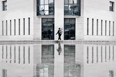 Symmetry (Hernan Piera) Tags: windows man reflection building architecture walking photography photo arquitectura agua walks foto photographer image edificio pic ventanas backpack reflejo fotografia hombre imagen mochila fotografo caminando camina blinkagain hernanpiera