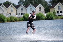 Wake boarding with the Lodge in the background (johnrobertbarber) Tags: park water wake boarding cotswold