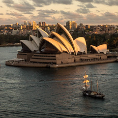 Tall ship passing Sydney Opera House (rogerofsalem) Tags: sunlight clouds buildings australia nsw newsouthwales operahouse masts tallships sydneyharbour cloudysky sydneyoperahouse warmsunlight