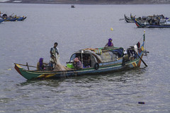 Colorful Cham boat (Keith Kelly) Tags: city cruise ladies sunset water colors evening boat fisherman women colorful asia cambodia seasia southeastasia fishermen capital phnompenh kh aroundtown mekong cham tonlesap boatride fisherwomen mekongriver kampuchea fisherladies