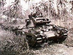 """A Matilda tank, named """"Clincher"""", moves towards Japanese strong points near Finschhafen, on 9 November 1943."""