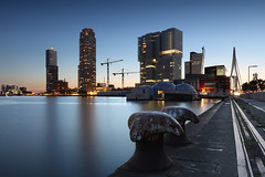 Rijnhaven (zsnajorrah) Tags: longexposure bridge sunset sky urban reflection water netherlands architecture night skyscraper rotterdam theater industrial crane text neworleans pavilion bluehour montevideo kopvanzuid bollard erasmusbrug derotterdam torenopzuid rijnhaven nieuweluxortheater rijnhavenbrug drijvendpaviljoen 7dmarkii tillemakade ef1635mmf4l