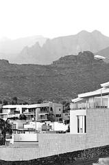 Slices. Tenerife 17 (arsenterzyan) Tags: ishootfilm eos5 canon analog xp2super ilford 35mm film bw travel cityscape rocks tenerife mountain street city