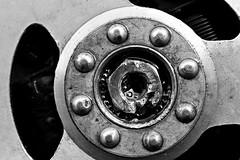 un piccolo intoppo - a little obstacle (immaginaitalia) Tags: germagnano valli di lanzo valleys piemonte piedmont italia italy nord north europa europe turin torino bn bw black white bianco nero mono monochrome monocromatico greyscale scala grigi ferro iron acciaio dado esagono sbloccante oil lavaggio rovinato ostacolo obastacle lambretta 125c old scooter vintage volano magnete