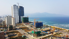 On the up and up (Roving I) Tags: hotels tourism travel cranes construction buildingsites highrises sea surf beach whitesand danang vietnam