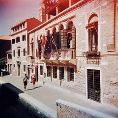 Venician footpath (sonofwalrus) Tags: holga film lomo lomography scan venice italy europe venezia italia xpro xprocessing buildings architecture footpath windows flags