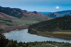 Full Moon Over Red Hills (Free Roaming Photography) Tags: road travel usa moon mountain lake mountains west water clouds season spring twilight moody cloudy dusk fullmoon nationalforest moonrise western northamerica remote dirtroad bluehour wyoming backroad windrivermountains bridgerteton redhills bridgertetonnationalforest grosventre slidelake fullflowermoon grosventremountains grosventreroad grosventres grosventreriver redhillsofthegrosventres