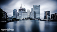 The Fiscal Jungle (Aaron Yeoman [Old Account]) Tags: city uk longexposure greatbritain houses england sky urban cloud motion building london art water glass lines skyline architecture modern clouds skyscraper buildings boats boat movement europe apartments cityscape skyscrapers unitedkingdom crane transport line cranes transportation slowshutter gb docklands canarywharf vignetting financial vignette hsbc a77 onecanadasquare isleofdogs towerhamlets watertransport cliffordchance northeastlondon barclaysbank neutraldensity 8canadasquare 10upperbankstreet nd110 sigma1020mm1456exdchsm sonya77 lee09ndgrad leebigstopper slta77